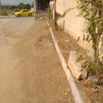 أعمال تنظيف وتعشيب شوارع واحياء في المدينة